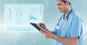 Male surgeon using digital tablet against medical diagram. Digital composite of Male surgeon using digital tablet against medical diagram Royalty Free Stock Photo