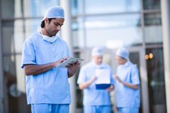 Male surgeon using digital tablet. At hospital Stock Photo