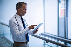 Male surgeon using digital tablet. At hospital Royalty Free Stock Image