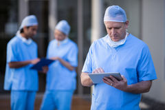 Male surgeon using digital tablet. At hospital Stock Photography