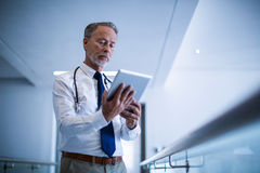 Male surgeon using digital tablet. At hospital Stock Photos