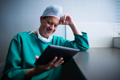 Male surgeon using digital tablet. Of hospital Stock Photos