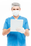 Male surgeon using tablet computer. Isolated on a white background Royalty Free Stock Image