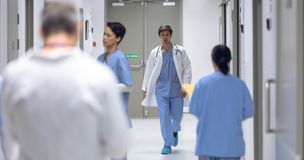 Male surgeon walking in corridor at hospital stock images