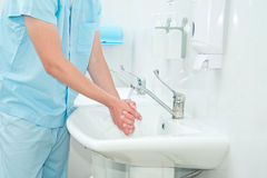 Male surgeon. Washes his hands before the operation Royalty Free Stock Image