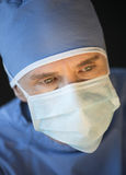 Male Surgeon Wearing Mask And Surgical Cap Stock Photos