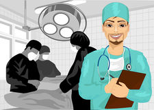 Male surgical nurse in operating room holding clipboard Stock Photography