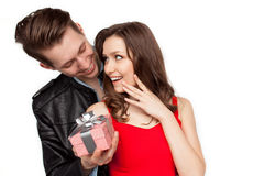 Male surprising girl with present Stock Image