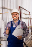 Male surveyor in coverall doing checkup and filling papers. Happy spanish male surveyor in coverall doing checkup and filling papers Royalty Free Stock Photography
