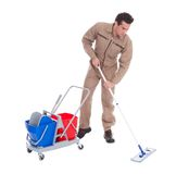 Male sweeper cleaning floor Royalty Free Stock Images