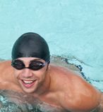 Male swimmer. Wearing cap and googles smiling Stock Photos