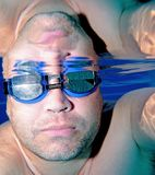 Male swimmer as seen underwater. Male, middle aged swimmer as seen underwater with blue goggles on Royalty Free Stock Photo