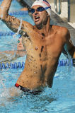 Male Swimmer Celebrating Victory In Pool Stock Photo