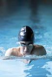Male swimmer doing breaststroke exercise Stock Photos