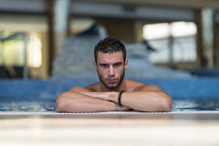 Male Swimmer Resting In Pool. Happy Attractive Man Resting Relaxed On Edge Of Swimming Pool Stock Photos