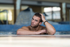 Male Swimmer Resting In Pool Stock Photos