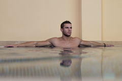 Male Swimmer Resting In Pool Royalty Free Stock Image