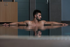 Male Swimmer Resting In Pool Stock Images