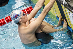 Male swimmer at starting block during 7th Trofeo citta di Milano swimming competition. MILAN, ITALY - March 10, 2017: Male swimmer at starting block during 7th Royalty Free Stock Photo
