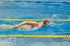 Male swimmer swimming freestyle in pool. Chelyabinsk, Russia - March 13, 2018: male swimmer swimming freestyle in pool during Championship Ural Federal District Stock Photo