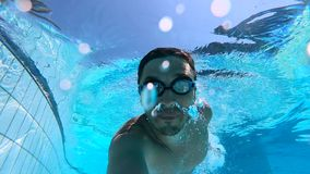 Male swimmer training in a pool, slow motion. HD stock video footage
