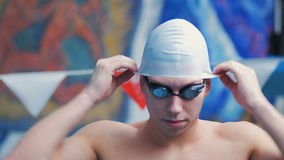 Male Swimmer Wears a Hat For Swimming stock video footage