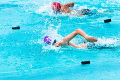 Male swimmers competing in freestyle stroke Stock Photo