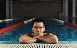 Male in swimming pool Stock Images