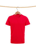 Male t-shirt on rope isolated on white. Background Stock Image