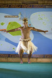 Male Tahitian Dancer at Polynesian Cultural Center. LA'IE, HI - JULY 26: Tahitian student performs a cultural dance in the Polynesian Cultural Center (PCC) in Royalty Free Stock Photography