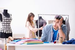 The male tailor with female student in workshop. Male tailor with female student in workshop Stock Images