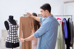 The male tailor with female student in workshop. Male tailor with female student in workshop Royalty Free Stock Photography