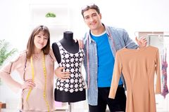 The male tailor with female student in workshop. Male tailor with female student in workshop Stock Photography