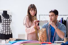 The male tailor with female student in workshop. Male tailor with female student in workshop Royalty Free Stock Photos