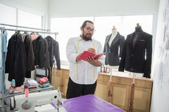 Male tailor in his workshop. Portrait of fashion designer and tailor in his workshop Stock Images
