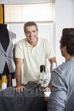 Male Tailor Leaning On Workbench In Factory Royalty Free Stock Photo