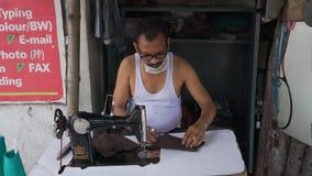Male tailor making cotton masks amid coronavirus pandemic