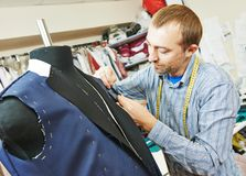 Male tailor portrait. Young male tailor portrait in workshop Stock Images