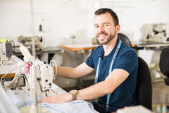 Male tailor sewing some clothes Stock Images