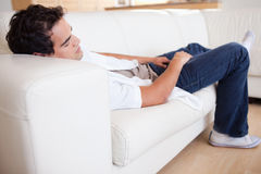Male taking a nap on the sofa Royalty Free Stock Images