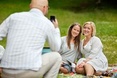 Male Taking Picture of Friends Royalty Free Stock Images