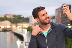 Male taking a selfie in the city with copy space.  Stock Photography