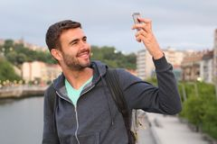 Male taking a selfie in the city.  Royalty Free Stock Photo