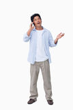 Male talking on the cellphone. Against a white background Stock Image