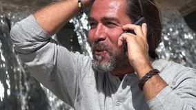 Male Talking On Phone. A handsome Spanish adult male Stock Photography