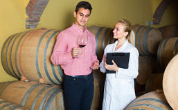 Male talking with technician. Male owner of winery talking with technician in cellar Royalty Free Stock Photography
