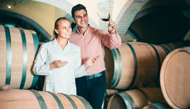 Male talking with technician. Male owner of winery having conversation with expert technician in cellar Stock Image