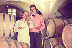 Male talking with technician. Male owner of winery having conversation with technician in  interior Royalty Free Stock Photography