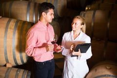 Male talking with technician. Male owner of winery having conversation with technician in workshop Royalty Free Stock Photography