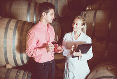Male talking with technician. Male owner of winery having conversation with technician in workshop Stock Image
